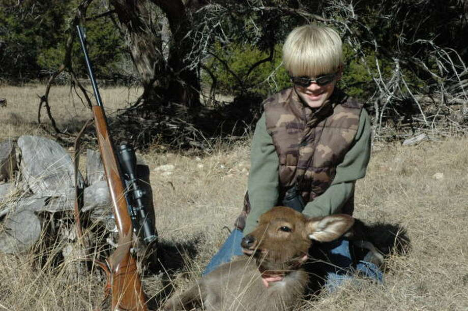 Tyler Morris, 11, on an exotic deer ranch near Mountain Home. (Originally published in 2010)