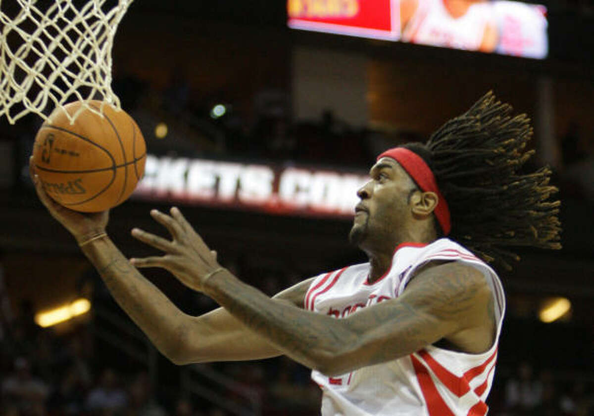 Rockets forward Jordan Hill flies to the basket during the first half of Wednesday night's game at Toyota Center.