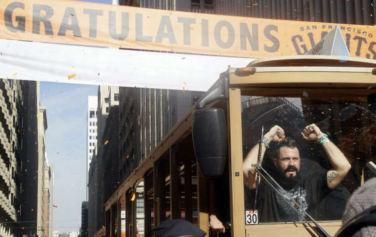 Giants reliever Brian Wilson celebrates while riding in a motorized cable car during Wednesday's parade. The Giants defeated the Texas Rangers in five games for their first championship since the team moved west from New York 52 years ago.