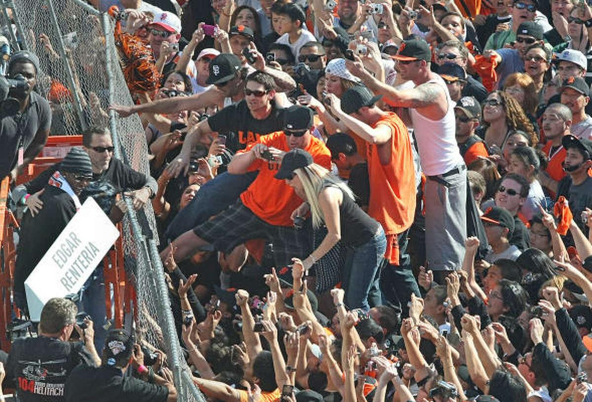 San Francisco's Edgar Renteria (in striped cap) celebrates with fans at Civic Center Plaza.