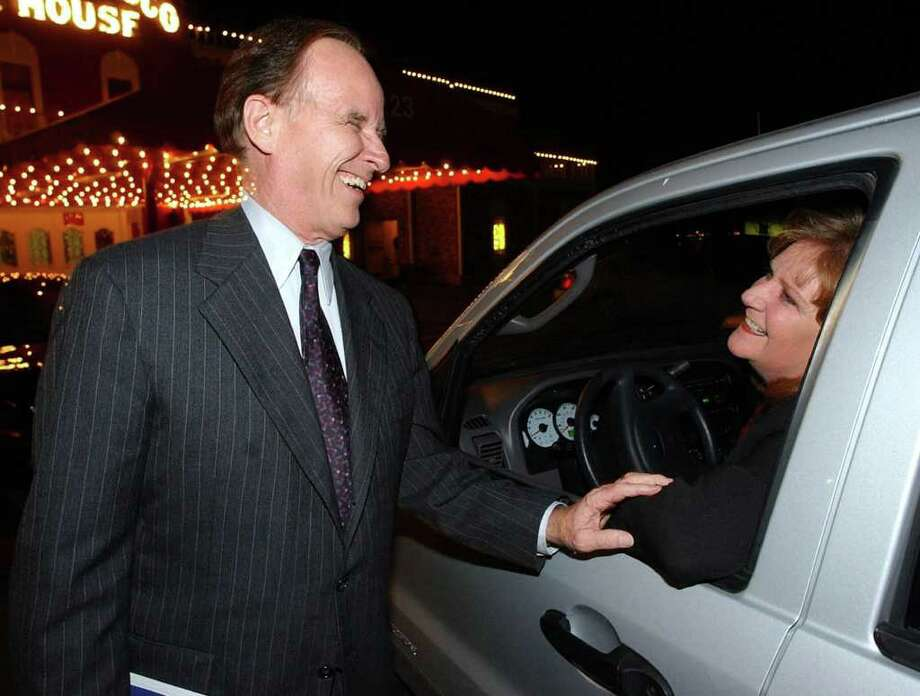 Cindy Taylor, president of the South San ANtonio Chamber of Commerce, was all smiles with County Judge Nelson Wolff in 2002 after learning that Toyota had voted to locate a manufacturing plant in South San Antonio. Photo: JOHN DAVENPORT, SAN ANTONIO EXPRESS-NEWS / SAN ANTONIO EXPRESS-NEWS