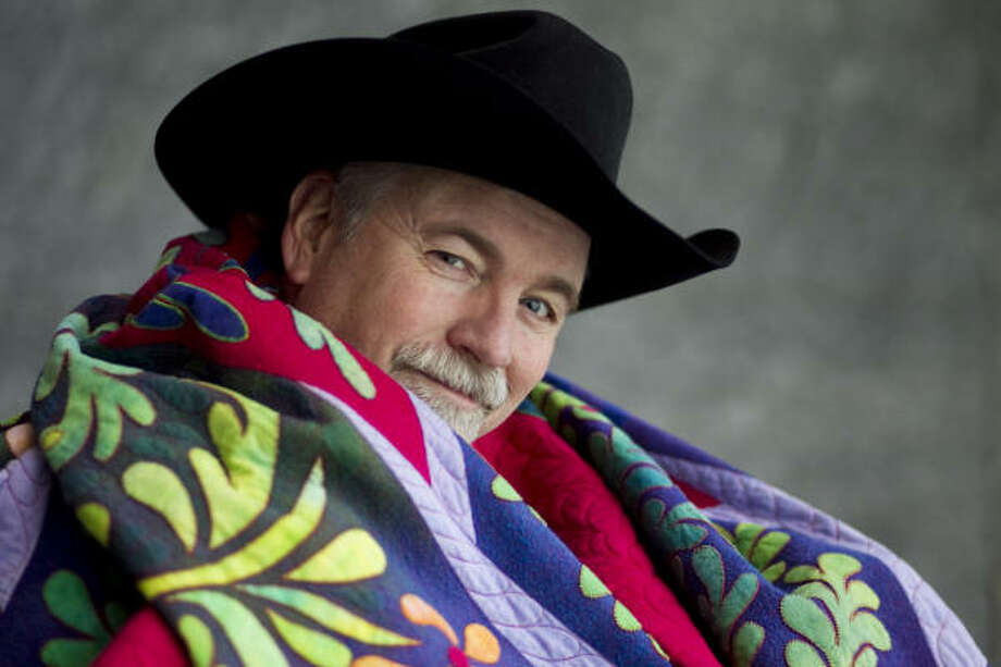 Ricky Tims is a quilt maker who is widely known through an internet subscription following of about 70,000 people. Tims poses with one of his quilts during the International Quilt Festival at the George R. Brown Convention Center in Houston. Photo: Nick De La Torre, Houston Chronicle