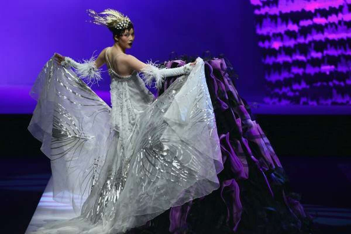 Fashion week is complete fantasy. Just take this snow queen in front of a purple-and-black volcano.