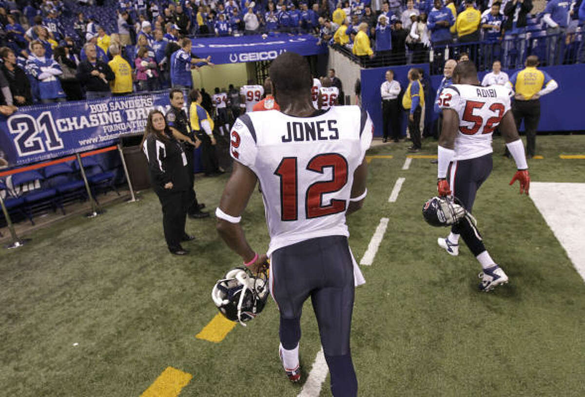 Texans wide receiver Jacoby Jones (12) walks back to the locker room after their loss to the Colts.