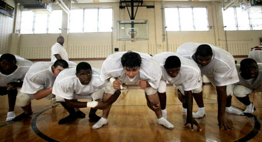 Lee High School's new football team's offensive line practices inside the school's gym last week. Photo: Julio  Cortez, Chronicle