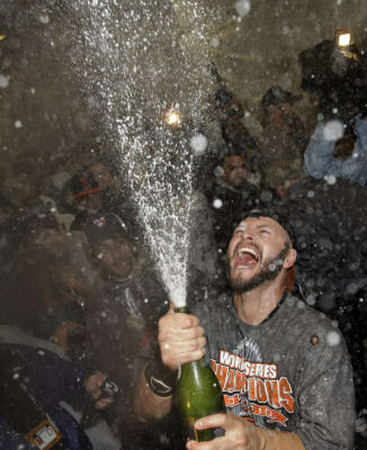 Giants left fielder Cody Ross sprays champagne to celebrate the victory.