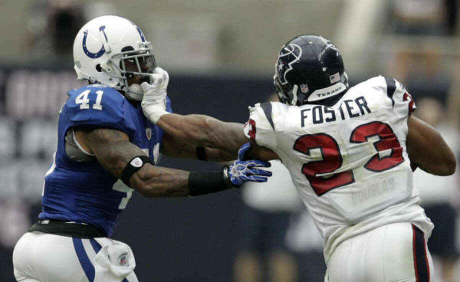 Arian Foster has been fined by the league for this uncalled facemask grab against Colts safety Antoine Bethea. Photo: Karen Warren, Chronicle