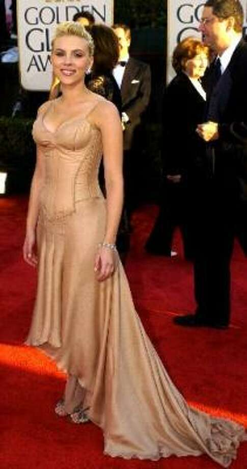 Today's corset is appearing more often on the outside rather than as an undergarment. Scarlett Johansson showed off a peach, floor-length, Roland Mouret corseted gown at the Golden Globes in 2009. Photo: Getty