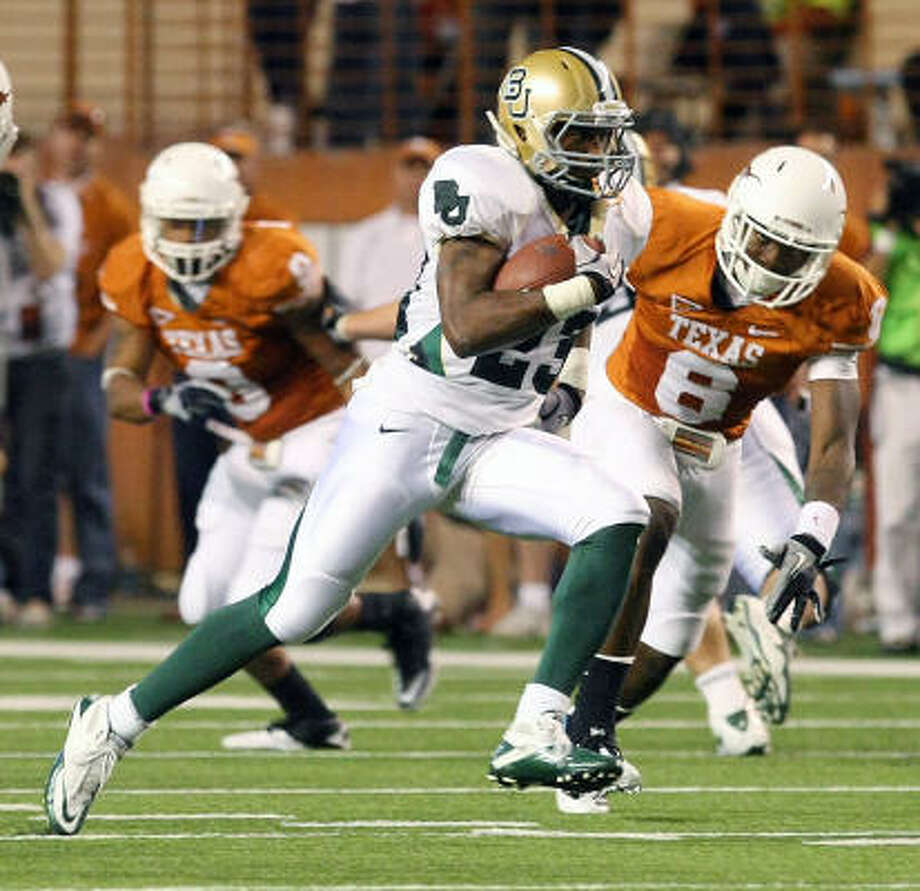 Oct. 30: Baylor 30, Texas 22  Baylor running back Jay Finley runs past Texas safety Christian Scott, right, for a second-half touchdown. Photo: Jerry Larson, AP