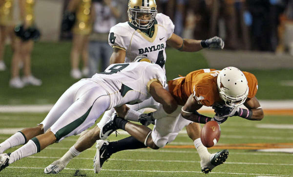 A hard hit by Baylor's Brad Taylor knocks the ball loose for an incompletion as a Texas wide receiver tries to get the Horn's out of a hole in the fourth quarter.