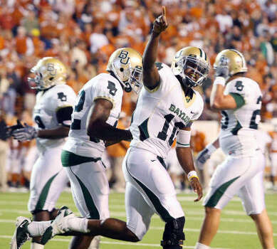 Baylor quarterback Robert Griffin celebrates his touchdown against Texas in the second half. Photo: Jerry Larson, AP