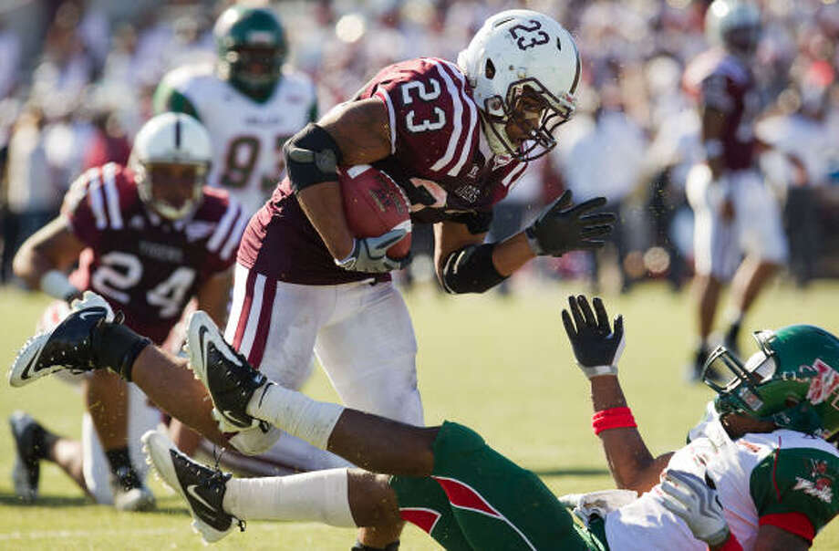 Oct. 30: Texas Southern 38, Mississippi Valley 7Texas Southern running back Marcus Wright (23) bowls over Mississippi Valley State cornerback Markkus Davis during the second half of Saturday's game at Delmar Stadium. Photo: Smiley N. Pool, Chronicle