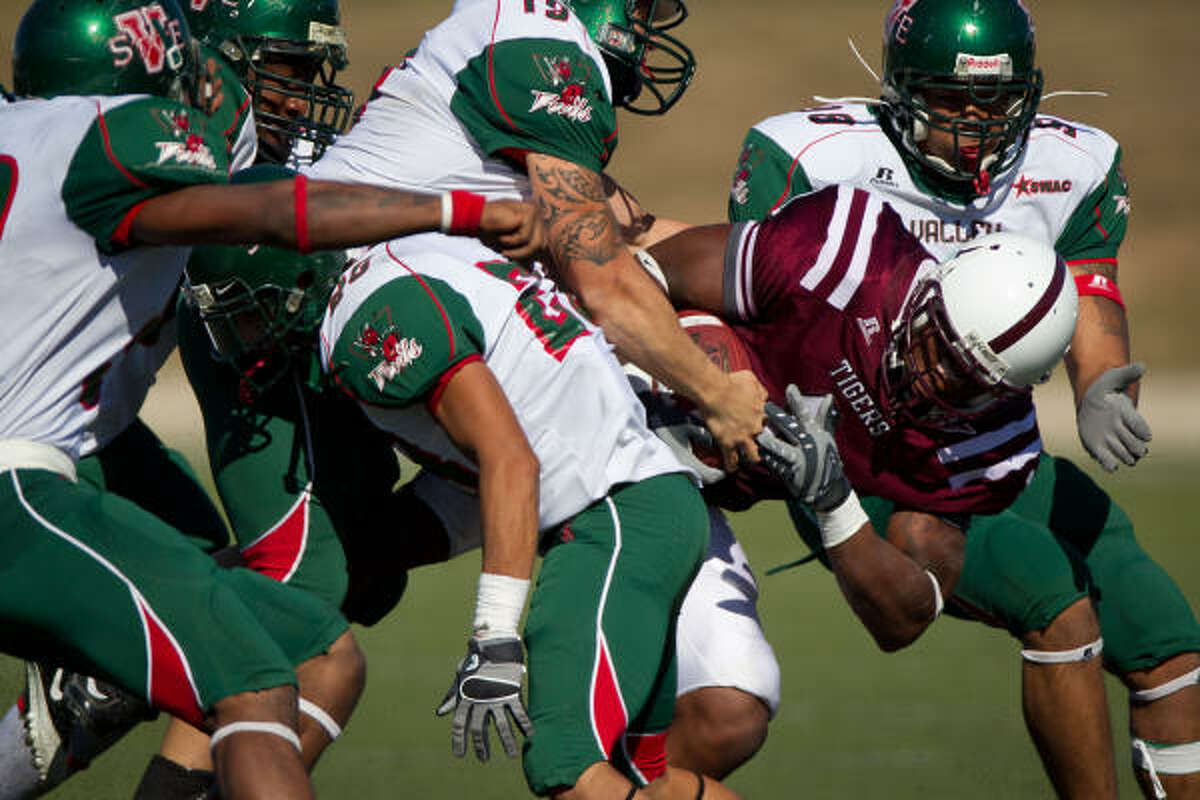 Texas Southern wide receiver Joseph Anderson (1) is brought down by a host of Mississippi Valley State defenders.