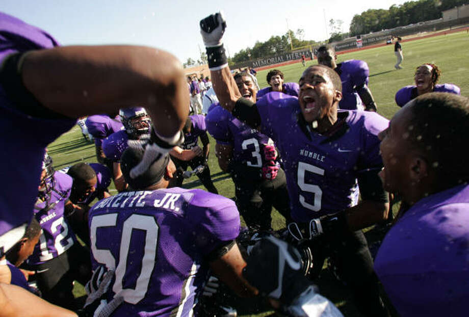 Oct. 30: Humble 41, Willis 10Humble's Jacoril Beck (5) and the rest of the Wildcats celebrate their big victory over Willis on Saturday at Turner Stadium in Humble. The Wildcats clinched the District 18-4A championship. Photo: ERIC CHRISTIAN SMITH, For The Chronicle