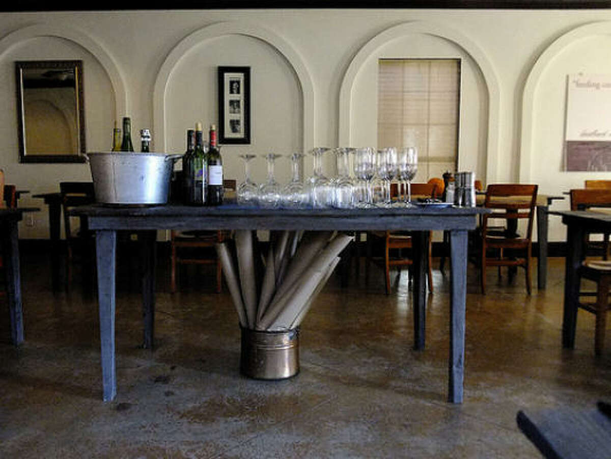 The new look in Bootsie's dining room: custom wooden tables, butcher paper coverings.