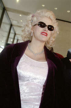 Smith wore a pale pink top with the word ''Spoiled'' beaded on it to court in 2001. Photo: Carlos Antonio Rios, Chronicle