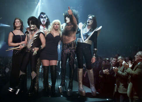 Smith is surrounded by members of KISS at the conclusion of the Spring/Summer Lane Bryant Lingerie Fashion Show in New York City in 2002. Photo: ROBERT MECEA, Associated Press