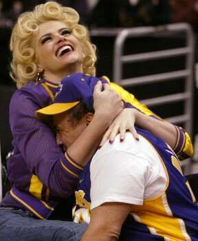 Smith, left, and Danny DeVito clown around during a Los Angeles Lakers' game in 2004. Photo: CHRIS CARLSON, Asssociated Press