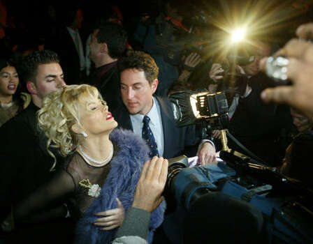 Smith causes a sensation for photographers after the Betsey Johnson fashion show in 2004, in New York City. Photo: KATHY WILLENS, Associated Press
