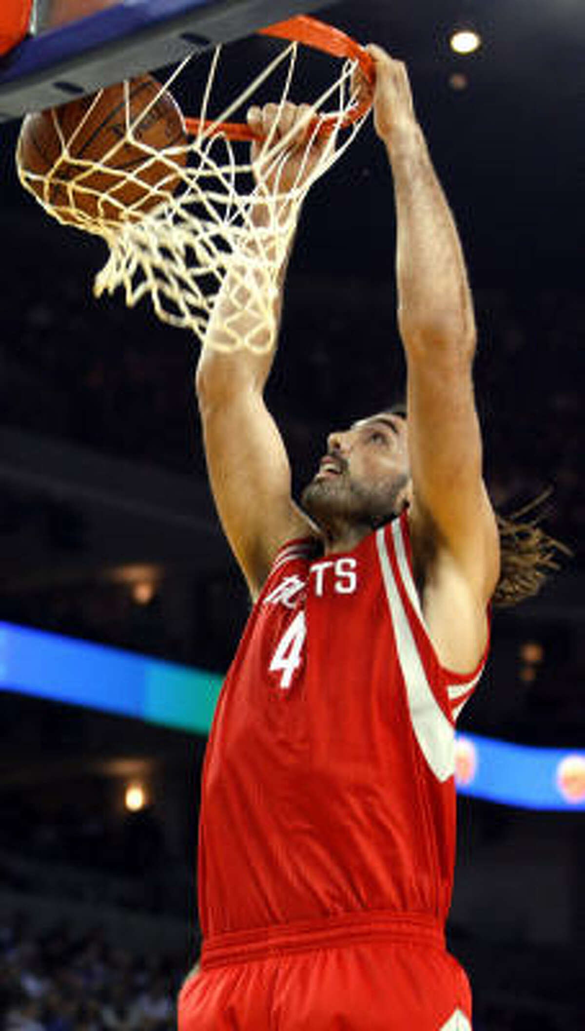 Rockets forward Luis Scola slams home a dunk in the first half.