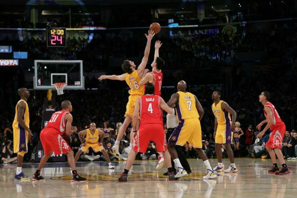 Lakers center Pau Gasol and Rockets center Yao Ming jump for the opening tip-off on Tuesday night.