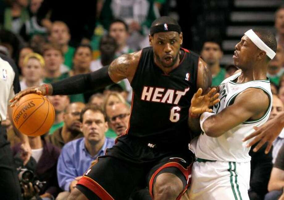 Heat forward LeBron James posts up Celtics forward Paul Pierce in the first quarter on Tuesday night. Photo: Jim Rogash, Getty Images