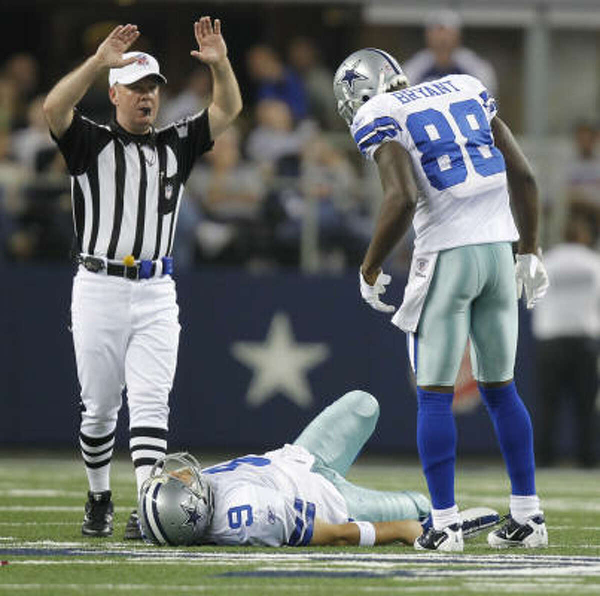 Oct. 25: Giants 41, Cowboys 35 Cowboys wide receiver Dez Bryant looks down at an injured Tony Romo, who suffered a broken left collarbone.
