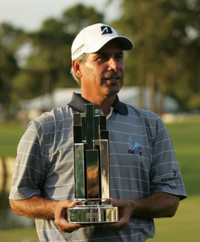 Fred Couples with the Administaff Small Business Classic following his victory. Photo: ERIC CHRISTIAN SMITH, For The Chronicle