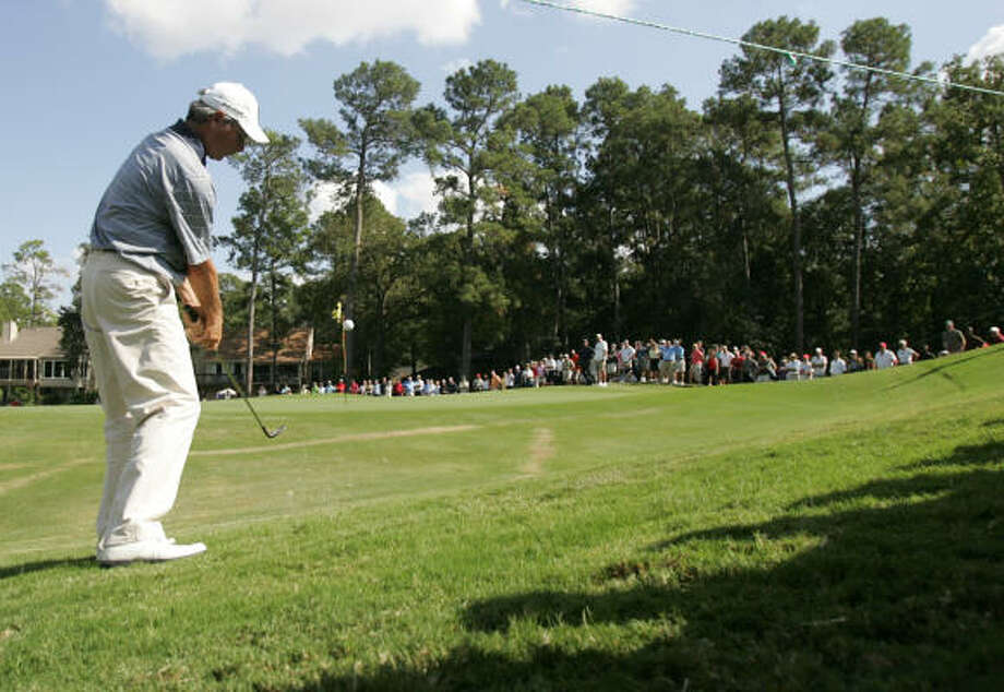 Fred Couples hits his second shot to the No. 8 green. Couples came up short of the green and had to settle for a double bogey during the final round. Photo: ERIC CHRISTIAN SMITH, For The Chronicle