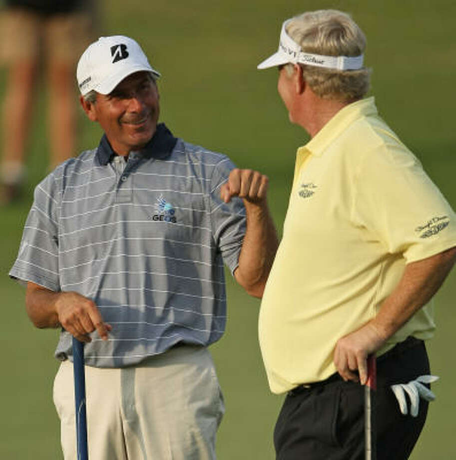 Fred Couples, left, gets a fist bump from partner Mark Wiebe on No.18 during the final round of play. Photo: ERIC CHRISTIAN SMITH, For The Chronicle