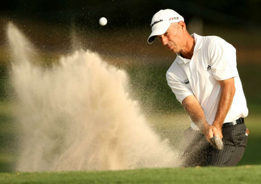 Oct. 23Corey Pavin eyes his greenside bunker shot on No. 15 during the secon