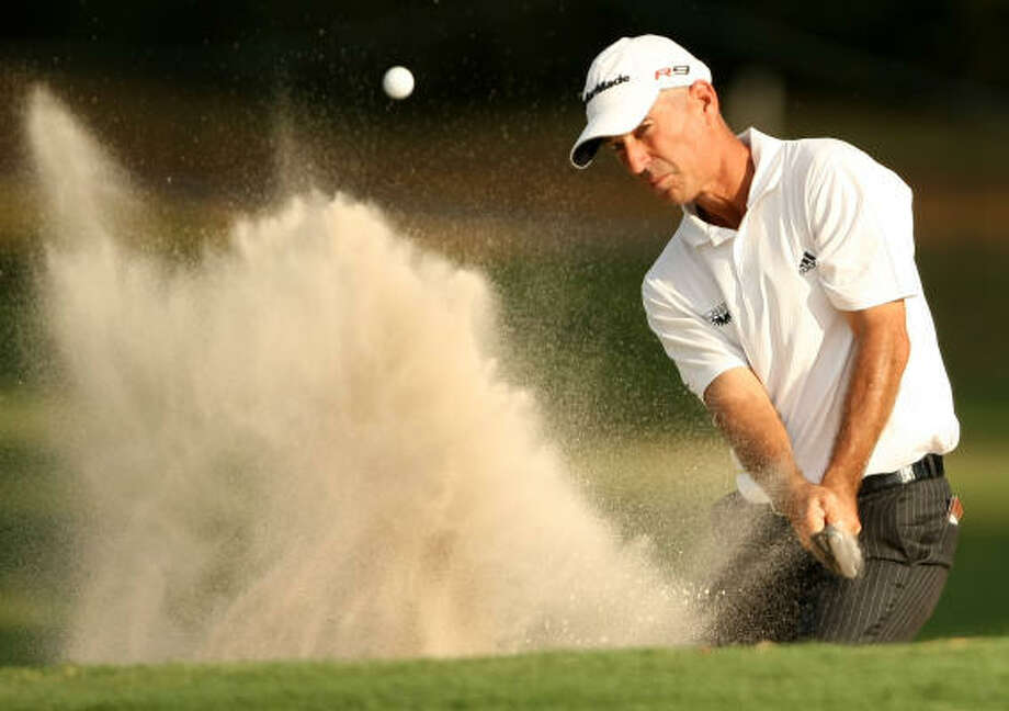 Oct. 23Corey Pavin eyes his greenside bunker shot on No. 15 during the second round. Photo: ERIC CHRISTIAN SMITH, FOR THE CHRONICLE