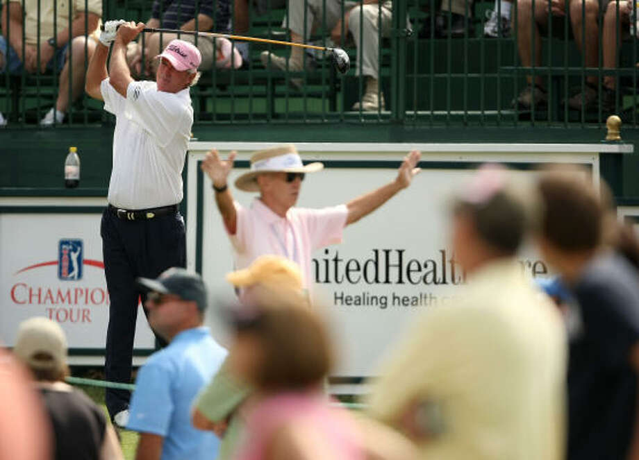 Russ Cochran eyes his tee shot on No.1 during the second round. Photo: ERIC CHRISTIAN SMITH, FOR THE CHRONICLE