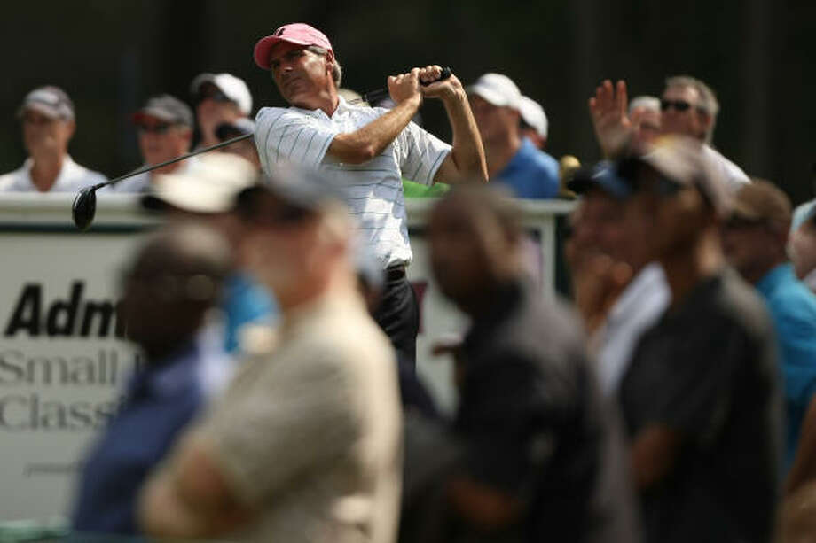 Fred Couples follows his tee shot on No. 12 during the second round. Photo: ERIC CHRISTIAN SMITH, FOR THE CHRONICLE