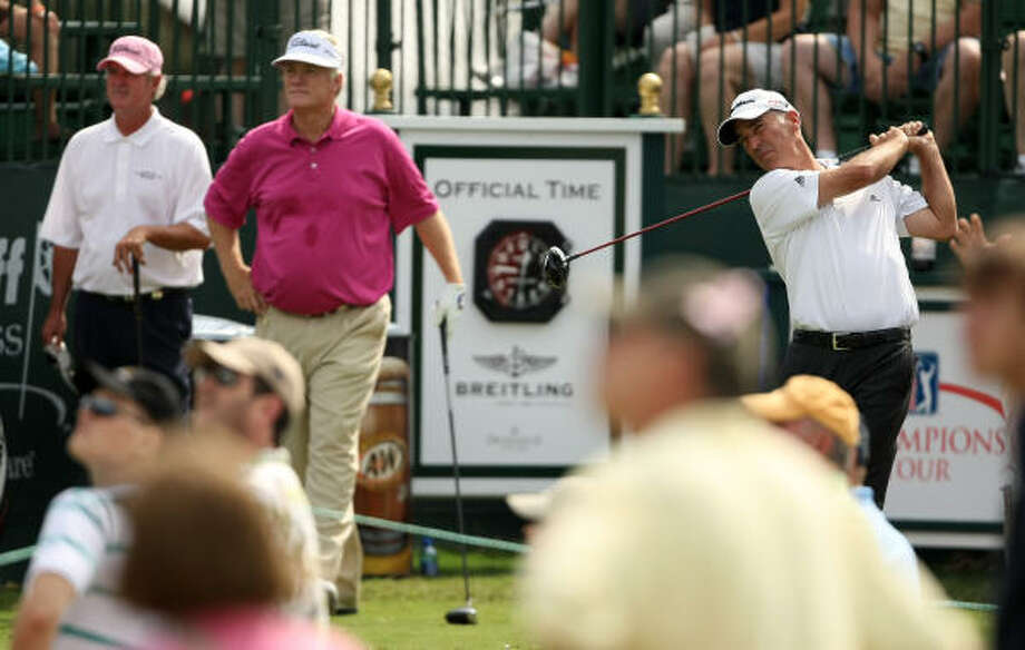 Corey pavin (right) follows his tee shot on No.1 as fellow competitors (l to r) Russ Cochran and Mark Wiebe look on during the second round. Photo: ERIC CHRISTIAN SMITH, FOR THE CHRONICLE