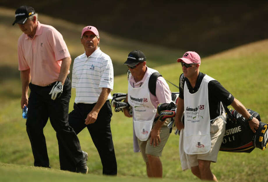 Hale Irwin (left) and Fred Couples make their way up the No. 12 fairway during the second round. Photo: ERIC CHRISTIAN SMITH, FOR THE CHRONICLE
