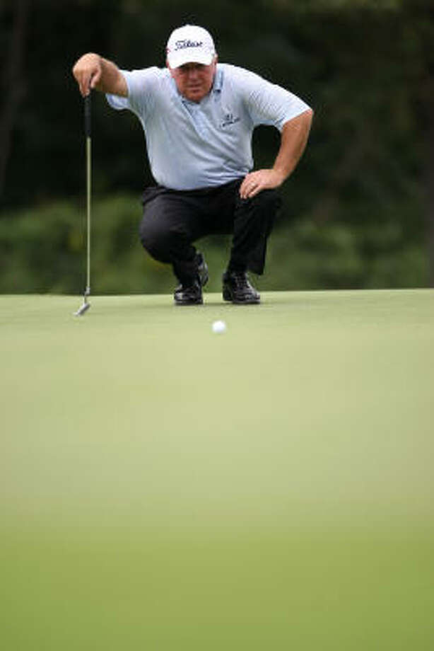 Mark O'Meara lines up his putt on the No. 6 green. Photo: ERIC CHRISTIAN SMITH, For The Chronicle
