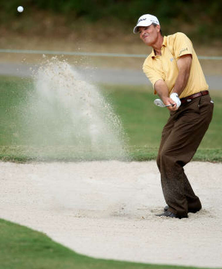 Ronnie Black blasts from a greenside bunker on No. 16. Photo: ERIC CHRISTIAN SMITH, For The Chronicle
