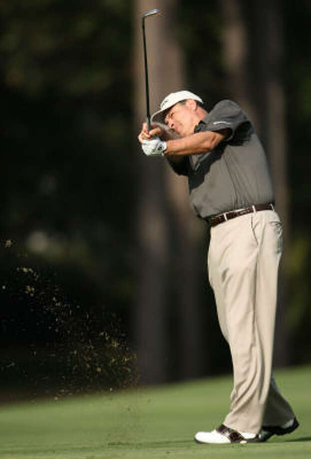 Loren Roberts follows through on his approach shot to No. 9. Photo: ERIC CHRISTIAN SMITH, For The Chronicle