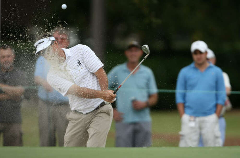 Kenny Perry blasts out of a greenside bunker on No. 1. Photo: ERIC CHRISTIAN SMITH, For The Chronicle