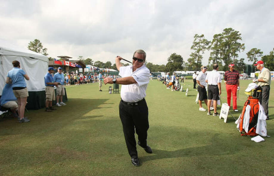 Fuzzy Zoeller loosens up on the practice range before the first round of play. Photo: ERIC CHRISTIAN SMITH, For The Chronicle