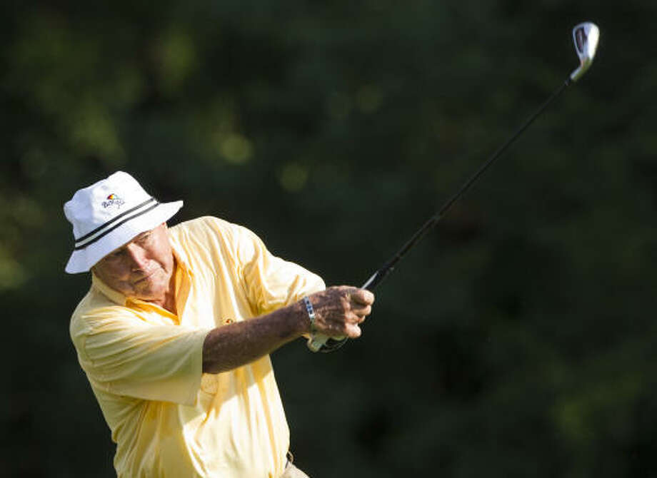 Oct. 21Legendary golfer Arnold Palmer hits a tee shot on No. 3 during Thursday's Championship Pro-Am at the The Woodlands Country Club Tournament Course. in The Woodlands. Photo: Brett Coomer, Chronicle