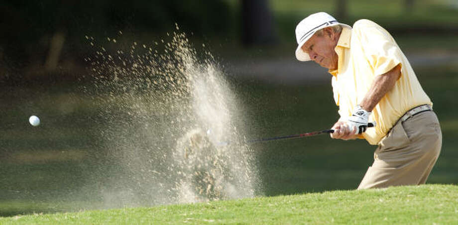 Arnold Palmer blasts out of the sand on No. 2. Photo: Brett Coomer, Chronicle