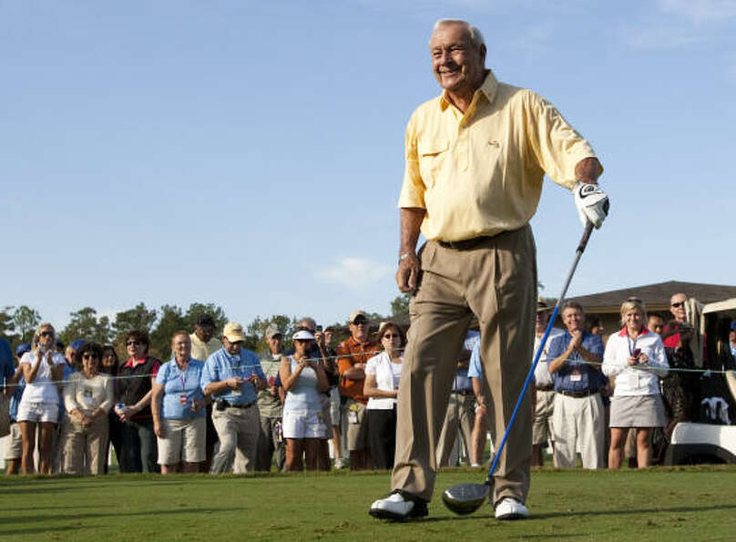 Arnold Palmer smiles as he walks off the tee box after hitting his drive on No. 1.