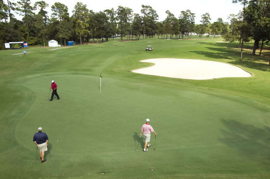 Phil Blackmar, in red, walks on the 10th green with his group during the United Health Care Pro-Am on Monday. Photo: Brett Coomer, Houston Chronicle