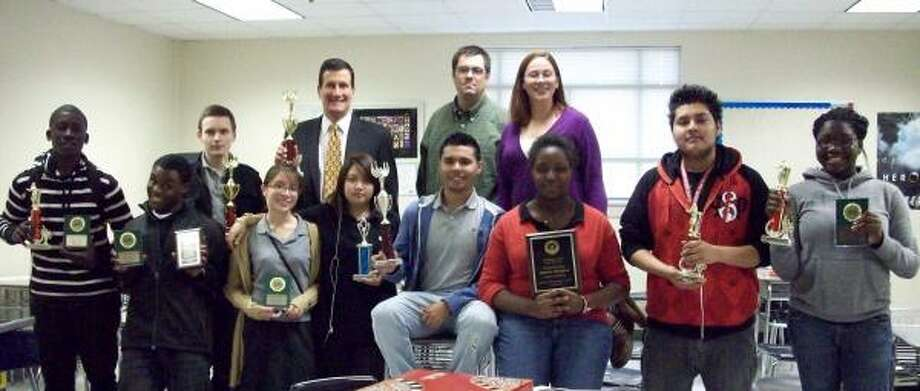 Members of the Westbury High School debate team include, left, front, Kennedy Onyeahialam, Roderick Hines, Mayra Herrera, Sokphanory Soeung, Alex Lopez, Sarah Iwuchukwu, Able Hernandez and Ife Falade. Back, left, are Goran Flajc, Darryl Carter, a mentor;  Stephen Jump and Marsha Jump, debate team mentors. Photo: Chelsea Hall, For The Chronicle