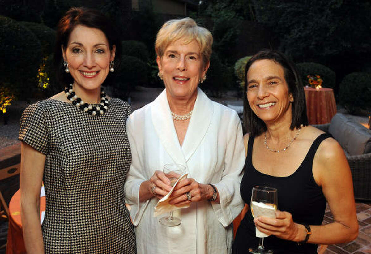 From left: Susie Criner, Nancy Manderson and Karen Strupp at the Gulf Coast's 25th anniversary celebration honoring Marion Barthelme at the home of Martha and Richard Finger.
