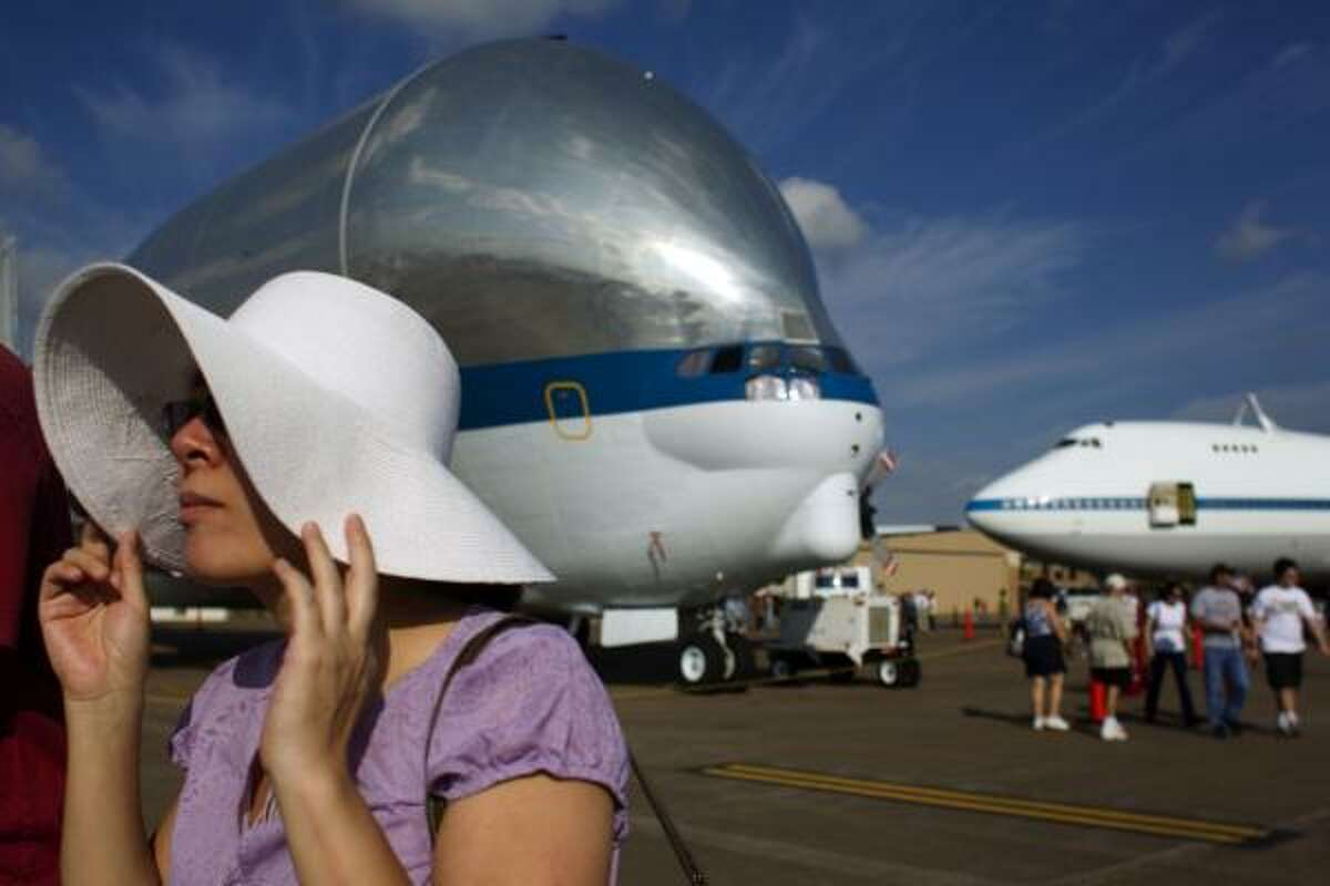 Qian Lu of Pearland, walks past the NASA owned B-377