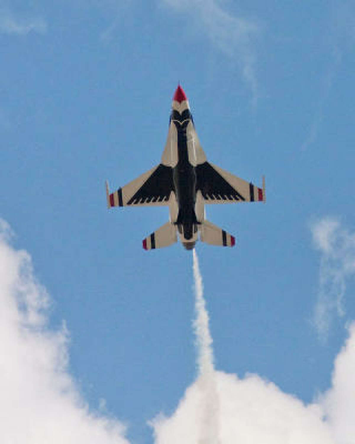 A Thunderbird zooms overhead at Ellington Airport.