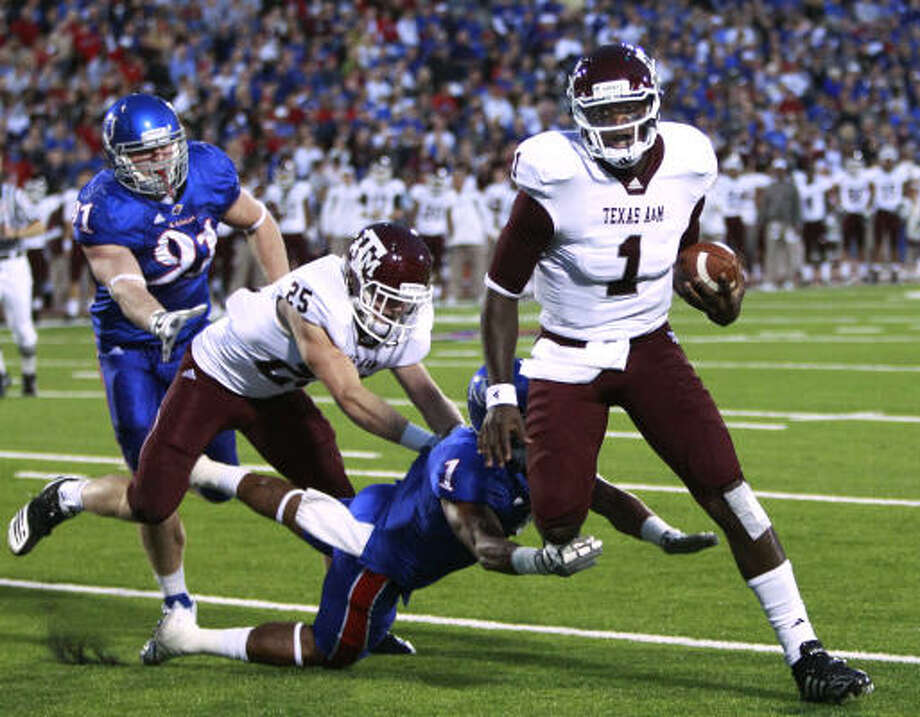 Oct. 23: Texas A&M 45, Kansas 10A&M quarterback Jerrod Johnson gets past Kansas safety Lubbock Smith for a touchdown during the first half. Photo: Orlin Wagner, AP